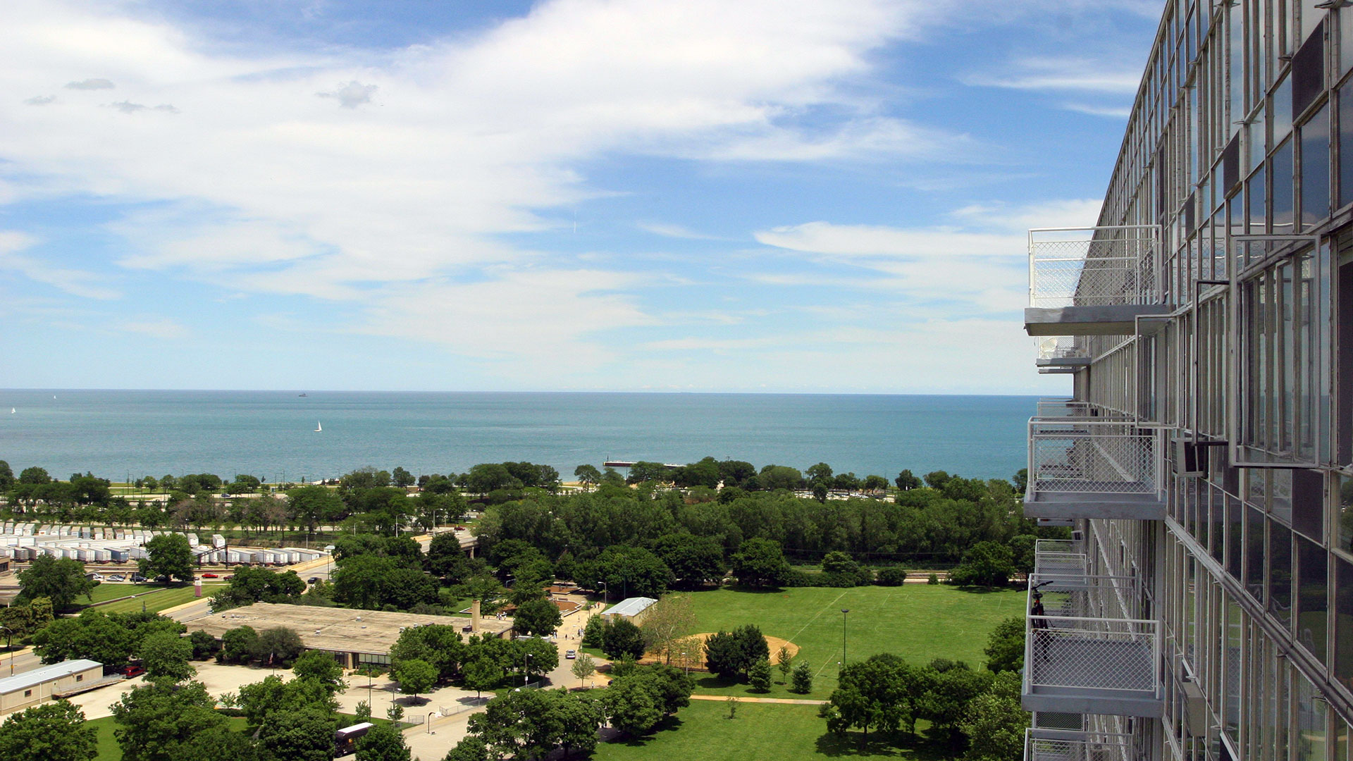 A view along the exterior of a Lake Meadows high rise with Lake Michigan seen just a short distance away.
