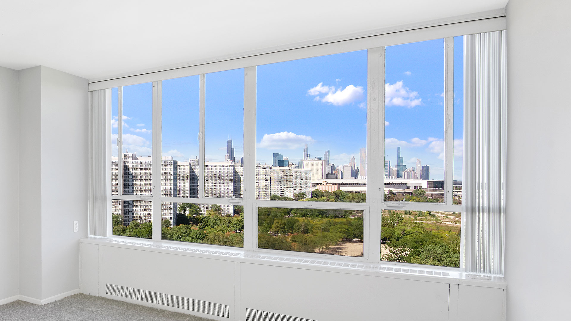 A view of the Chicago skyline looking north through a window in a mid-rise unit at Lake Meadows.